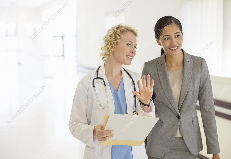 Doctor and businesswoman talking