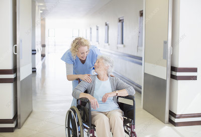 Nurse with aging patient in wheelchair