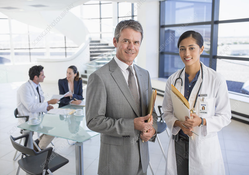 Smiling businessman and doctor in meeting