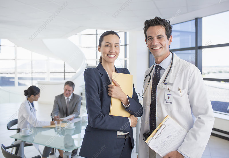 Smiling businesswoman and doctor
