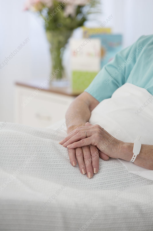Close up of senior patient's hands bed