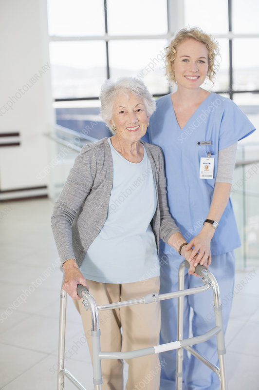 Smiling nurse and senior patient
