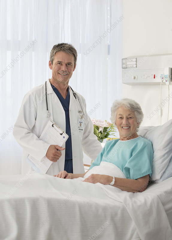 Smiling doctor and senior patient room