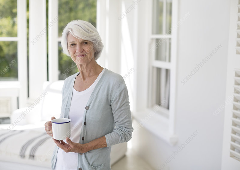 Senior woman holding cup of coffee