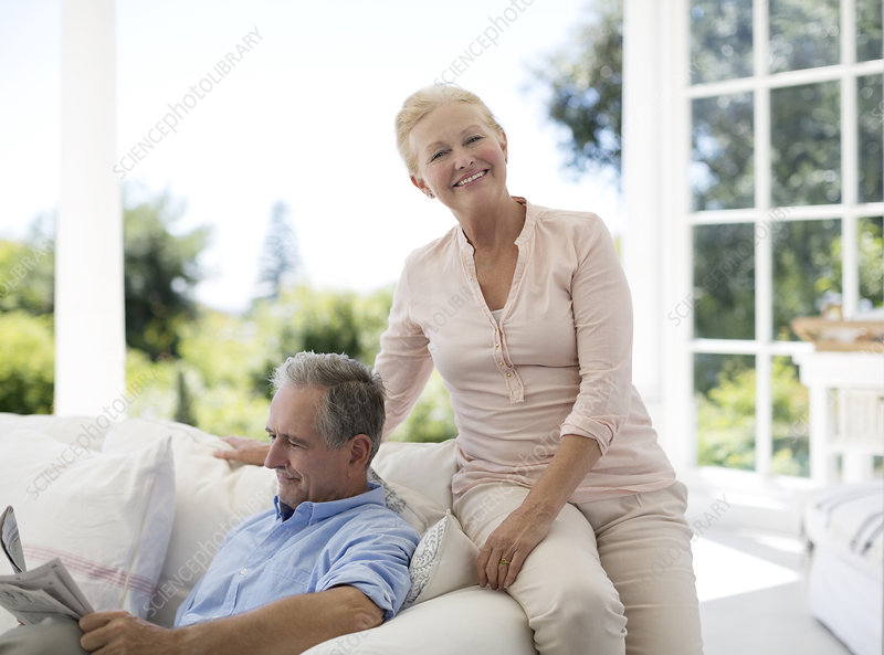 Senior couple relaxing on sofa on porch