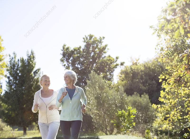 Senior women jogging in park