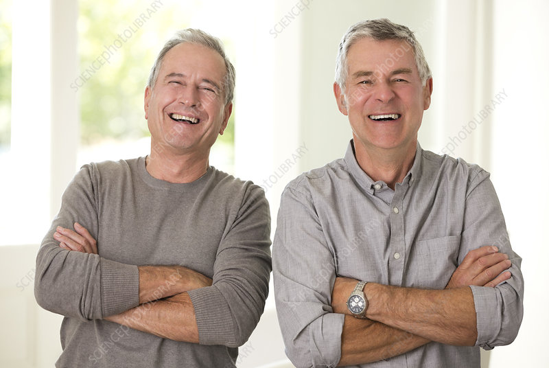 Senior men laughing with arms crossed