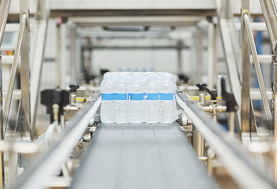 Water bottles on conveyor belt in factory