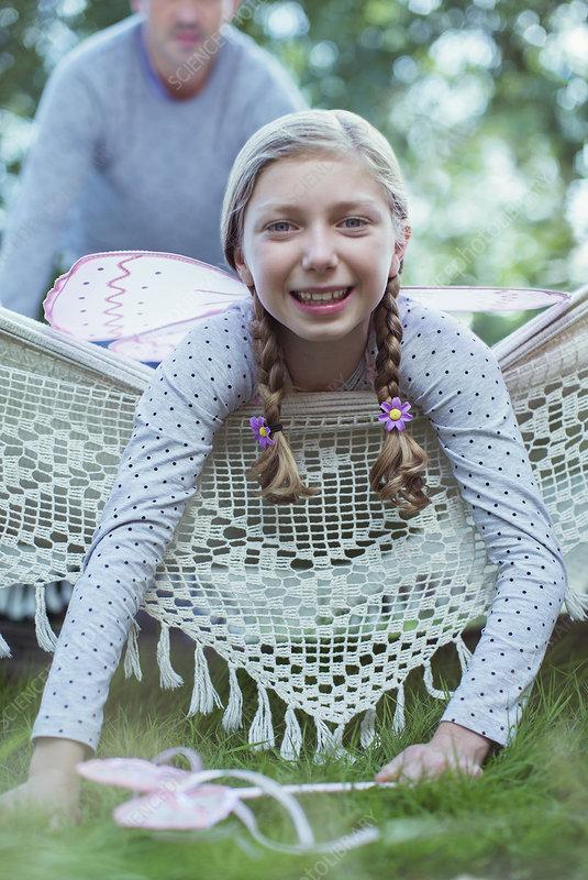 Smiling girl laying in hammock