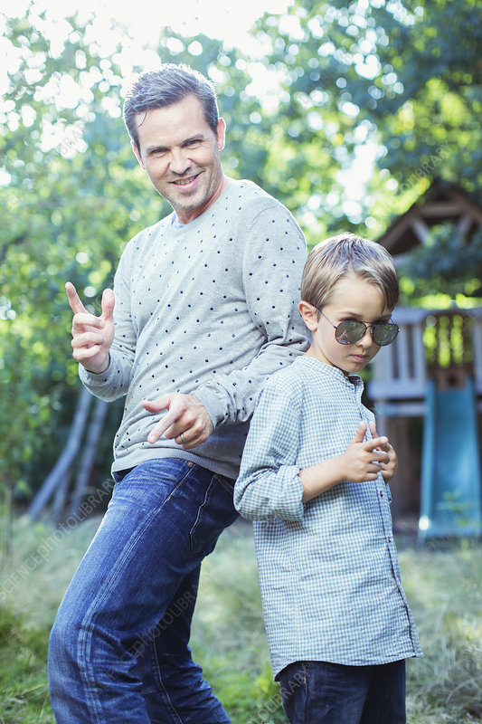 Father and son gesturing outdoors
