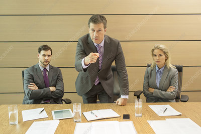 Businessman shaking his finger in meeting