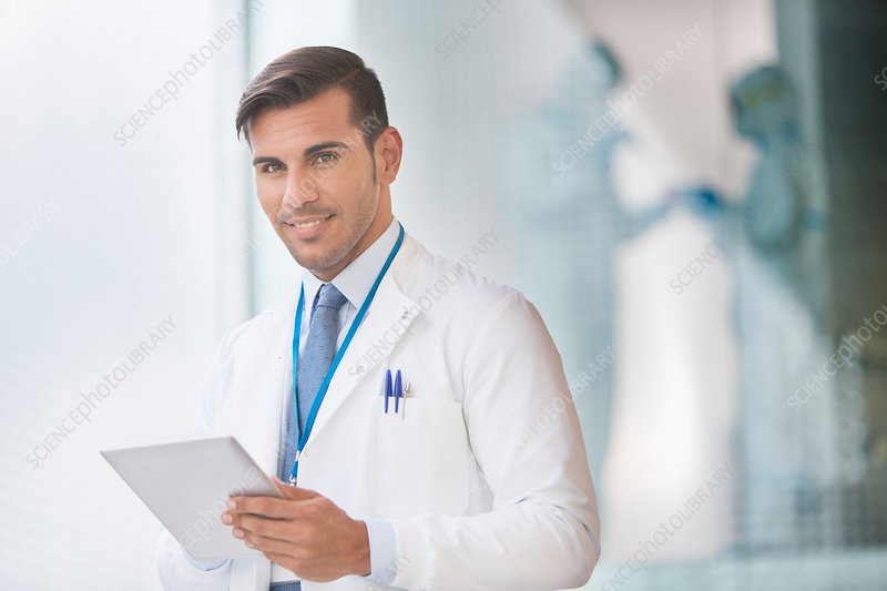Confident doctor with tablet