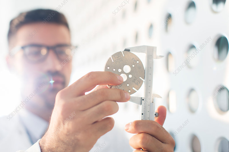 Scientist using callipers