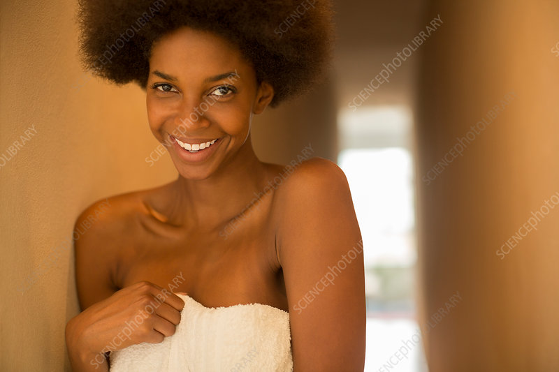 Smiling woman wrapped in towel