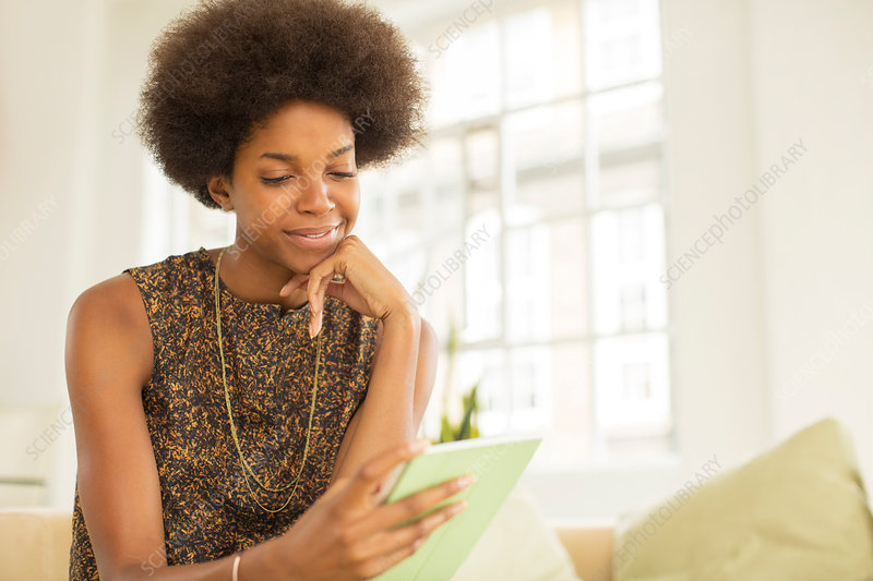 Businesswoman using tablet on sofa