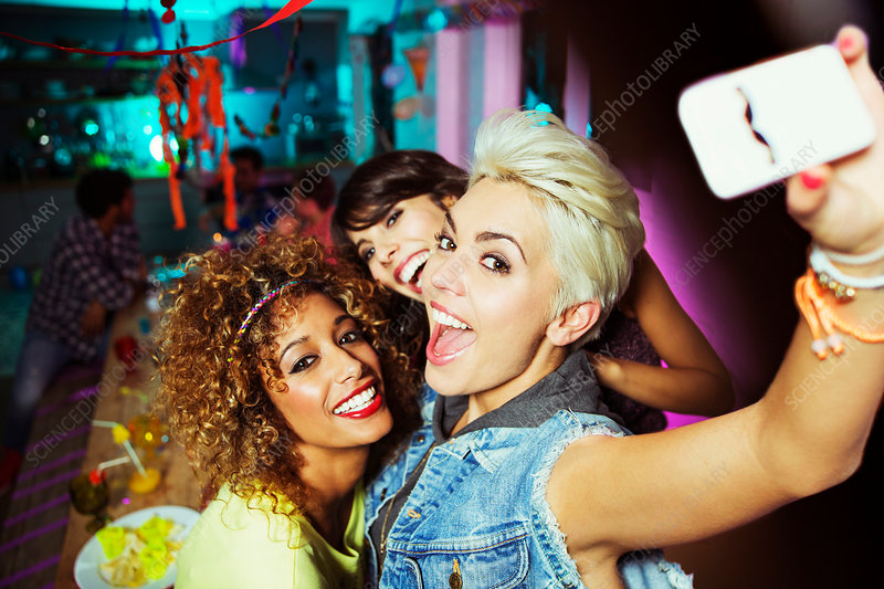Women taking self-portrait at party