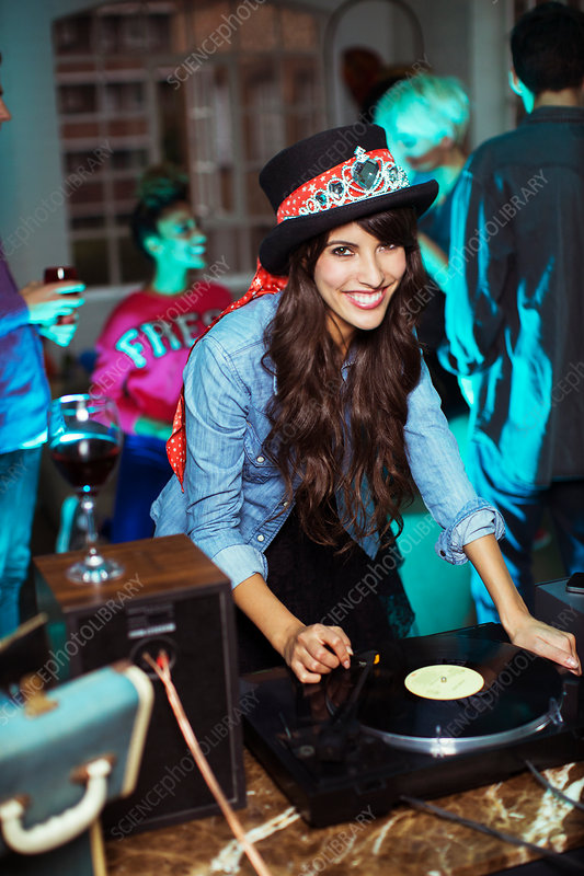 Woman playing records at party