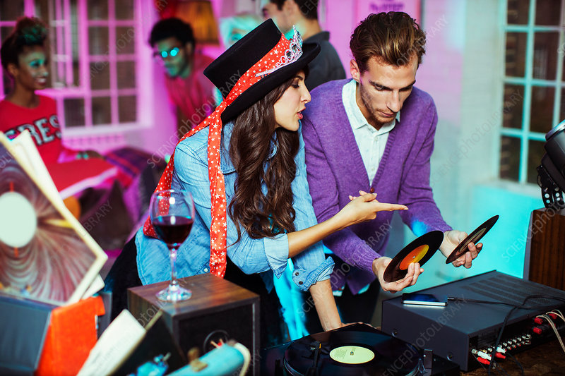 Couple playing records at party