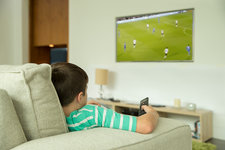 Boy watching television in living room
