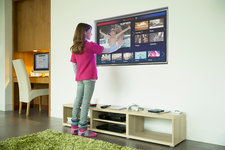 Girl using touch screen television