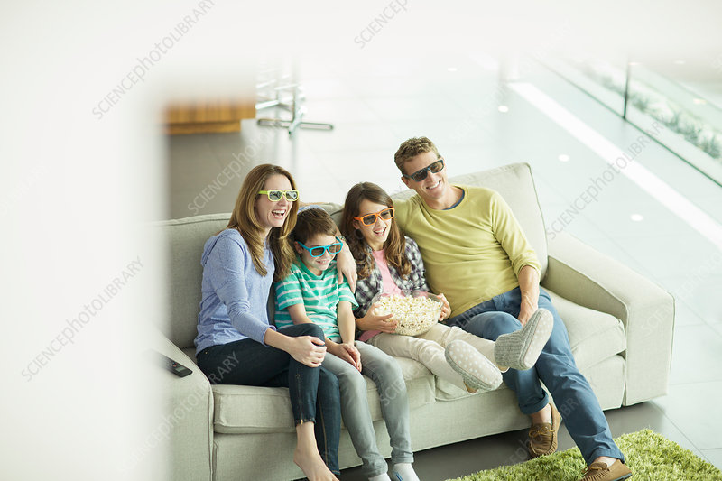 Family watching 3D television