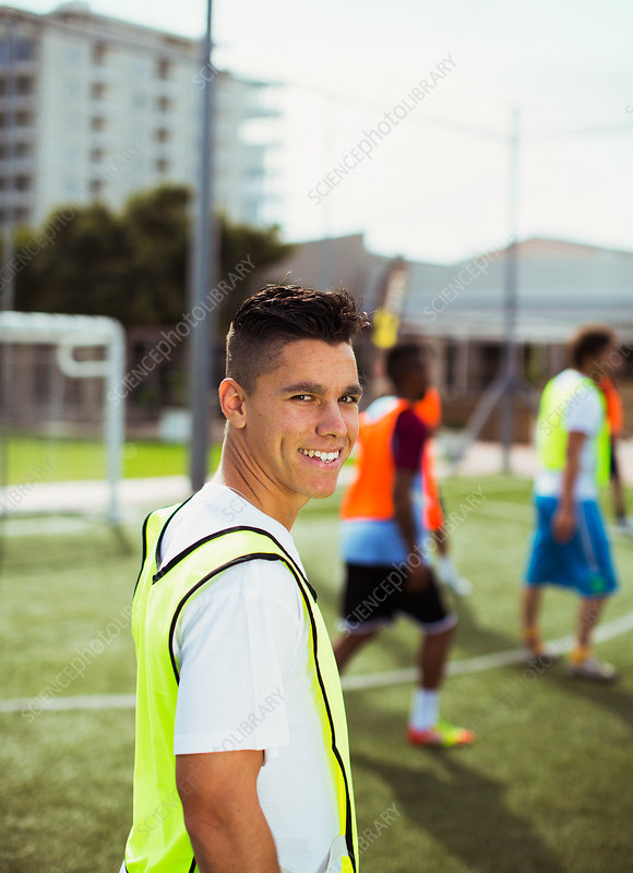 Soccer player smiling on field