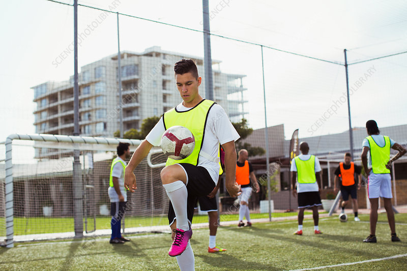 Soccer player training on field