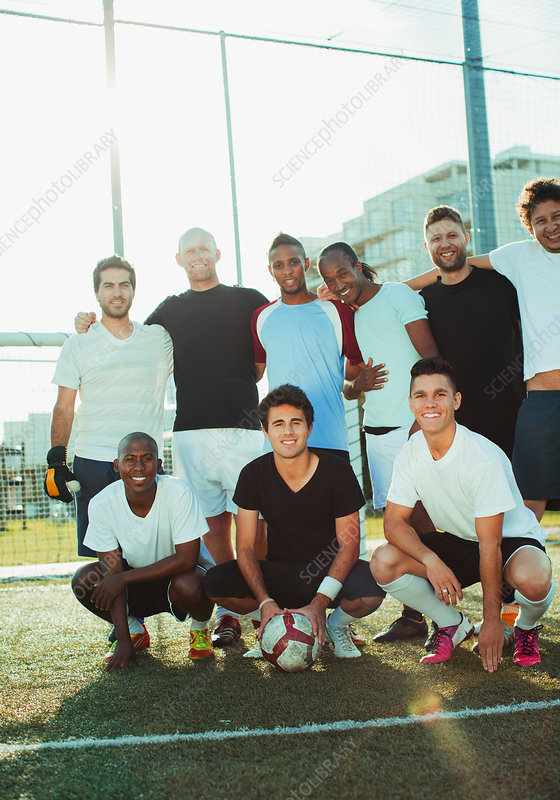 Soccer players smiling on field