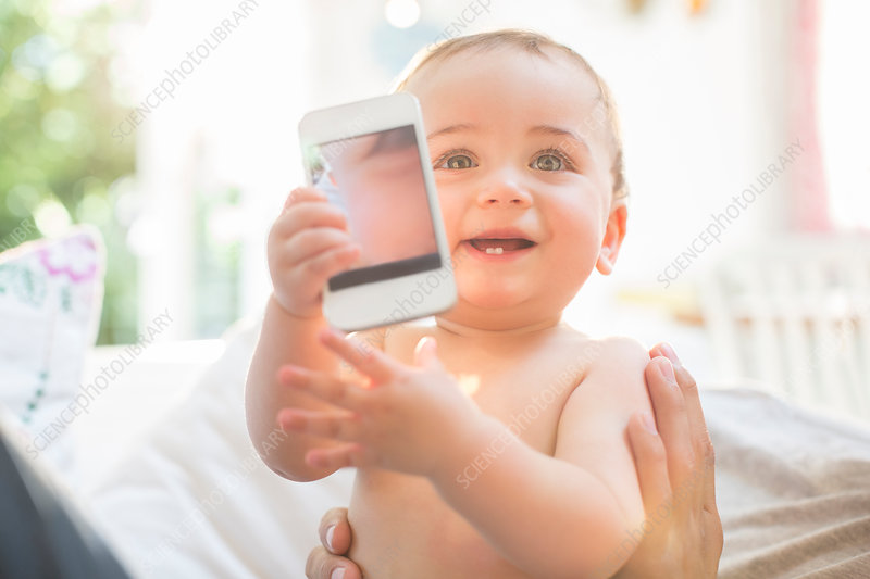 Baby boy playing with cell phone
