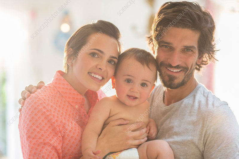 Parents smiling with baby boy