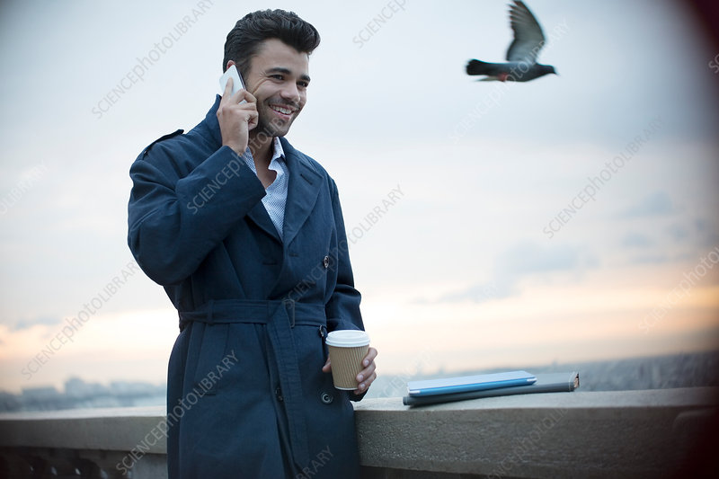 Businessman on cell phone outdoors