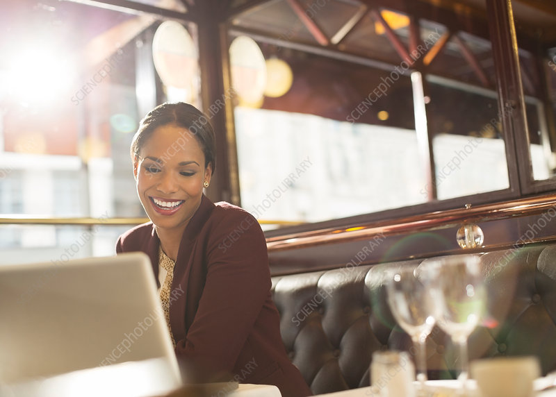 Businesswoman working in restaurant