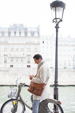 Businessman using cell phone in Paris