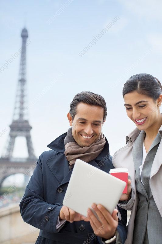 Business people using tablet in Paris