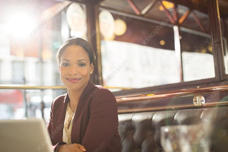 Businesswoman smiling in restaurant
