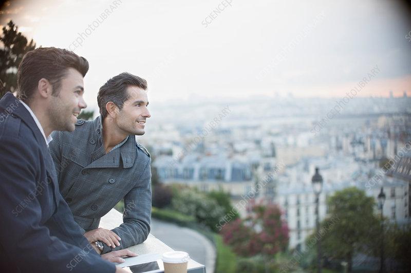 Businessmen overlooking cityscape, Paris