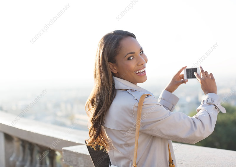 Businesswoman taking pictures