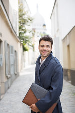Businessman smiling on street in Paris