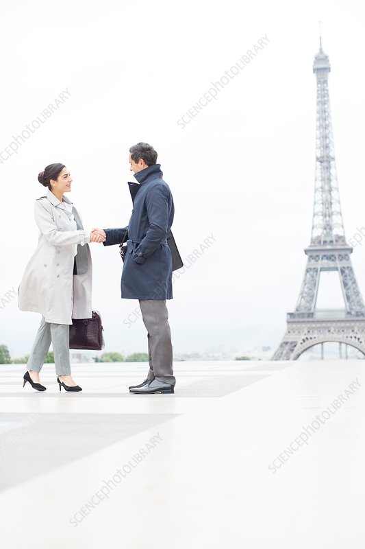 Business people shaking hands in Paris