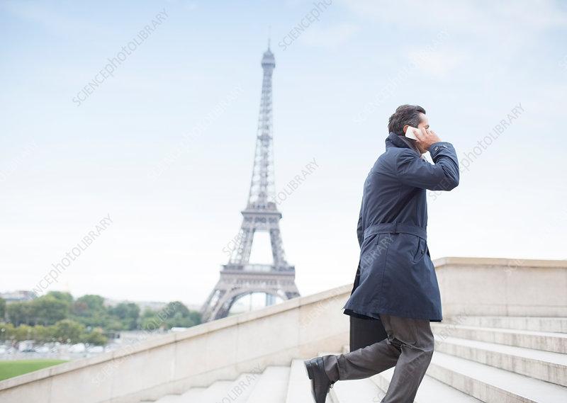 Businessman talking on phone in Paris