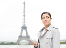 Businesswoman using cell phone in Paris