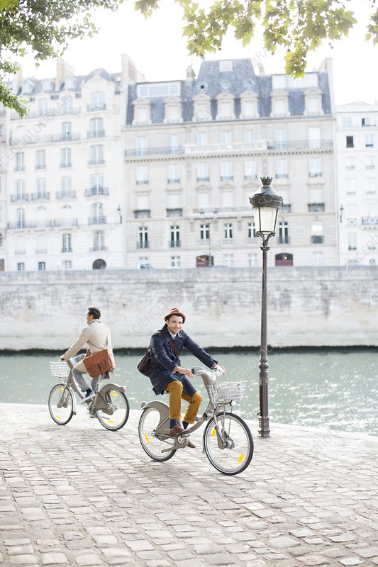 Men riding bicycles in Paris
