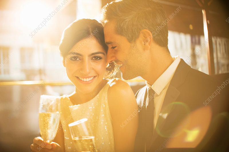 Couple having champagne together