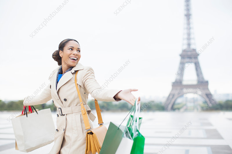 Woman carrying shopping bags, Paris
