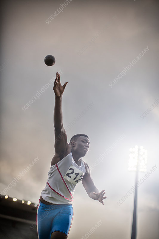 Track and field athlete throwing shot put