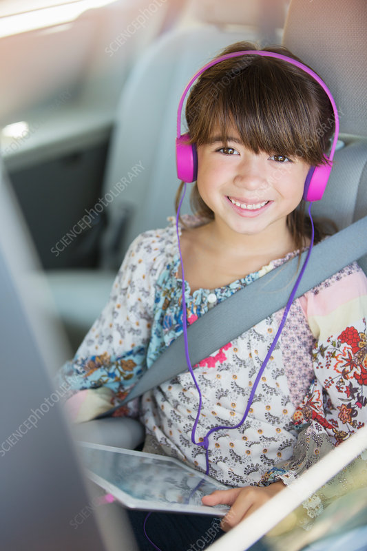 Happy girl with headphones using tablet