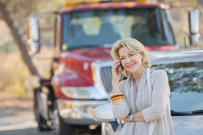 Woman talking near tow truck