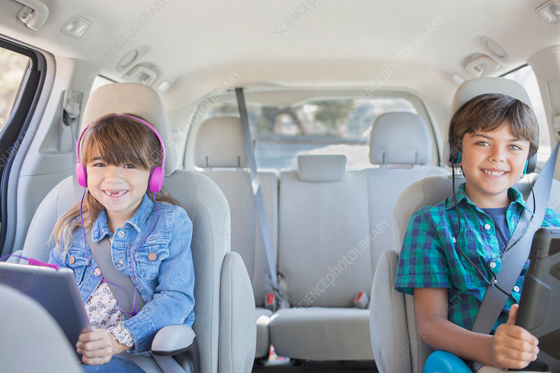 Brother and sister with headphones