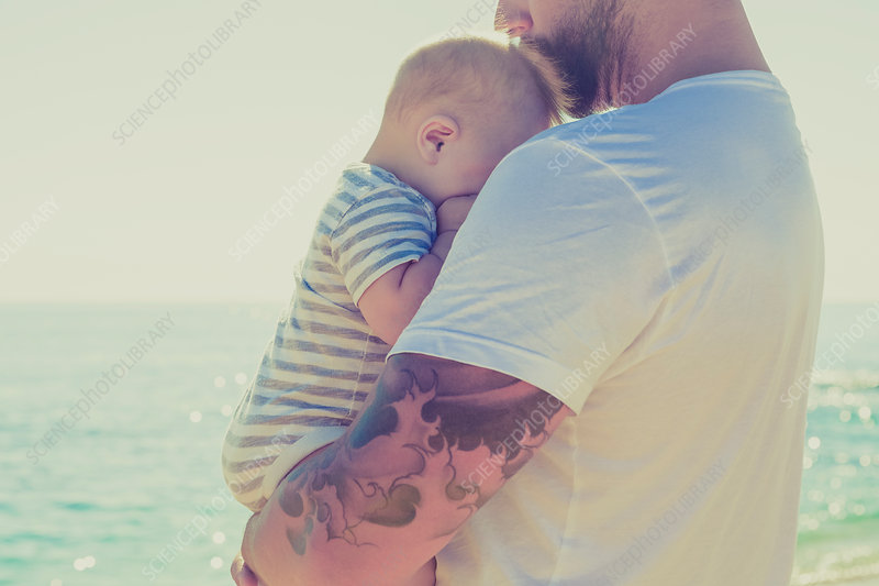Close up of father holding baby son