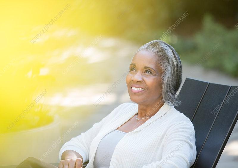 Happy senior woman sitting on patio